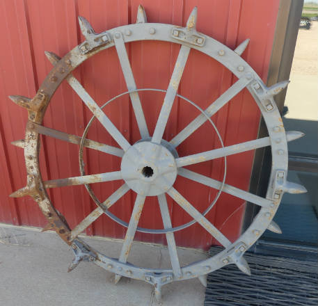 Used -- yard art -- oliver steel wheel
