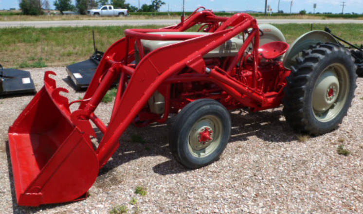 Used Ford 641 tractor with loader - rebuilt engine, new clutch, 							new gas tank, new tires and rims, factory power steering